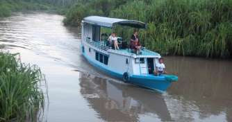 Image result for boat trip to camp leakey borneo