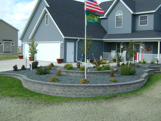 Retaining Wall Landscaping Around Flag Pole | Oasis Landscapes | West Fargo | Fargo | Moorhead