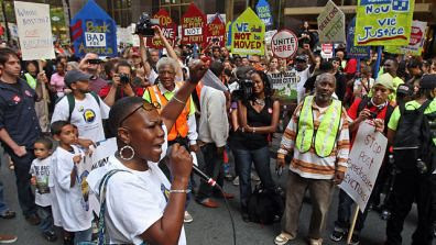 3,000 people gathered outside the Bank of America on October 1, 2011 to protest the role of financial industry in the economic crisis in the United States. The protest is connected with the Wall Street occupation in NYC. by Pan-African News Wire File Photos