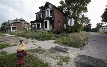 A vacant blighted home is seen on West Grand Boulevard, a once thriving neighborhood, in Detroit, Michigan July 23, 2013. REUTERS/ Rebecca Cook