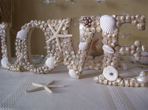 nautical beach weddings seashell wedding sign   OneWed.com