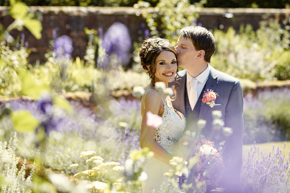 Stunning wedding photo of bride and groom at Lanwades Hall Wedding Photos - helloromancephotography.com