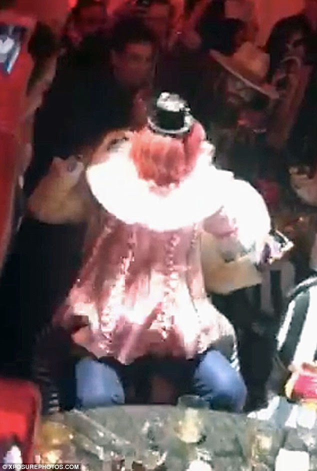 Comfy: Madonna straddled the mystery man as she continued with her performance