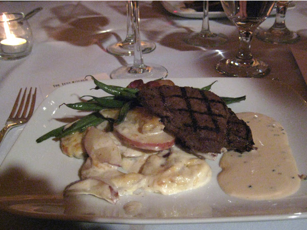 pan-seared pepper coated bison medallions with peppercorn-cognac cream, cheese taters and porky green beans