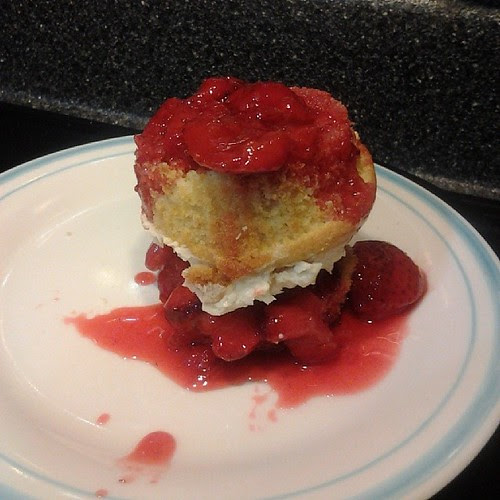 Strawberry shortcake made easy. Slice a cupcake in half, place strawberries on bottom half. Flip top with frosting over and add more strawberries on top.