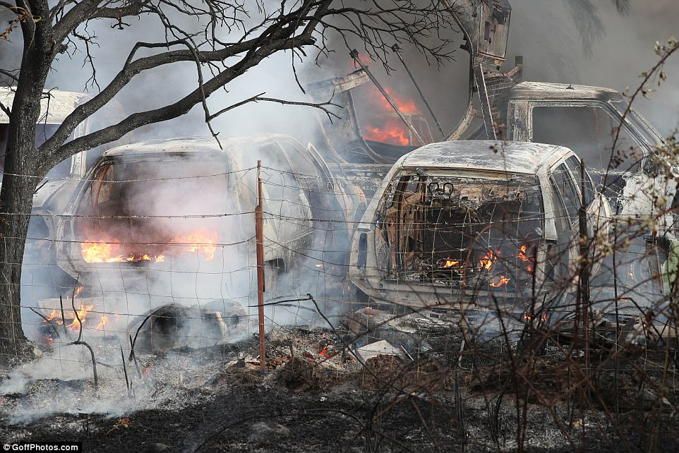 A number of cars are pictured having been destroyed by the fire sweeping across parts of the island of Corsica