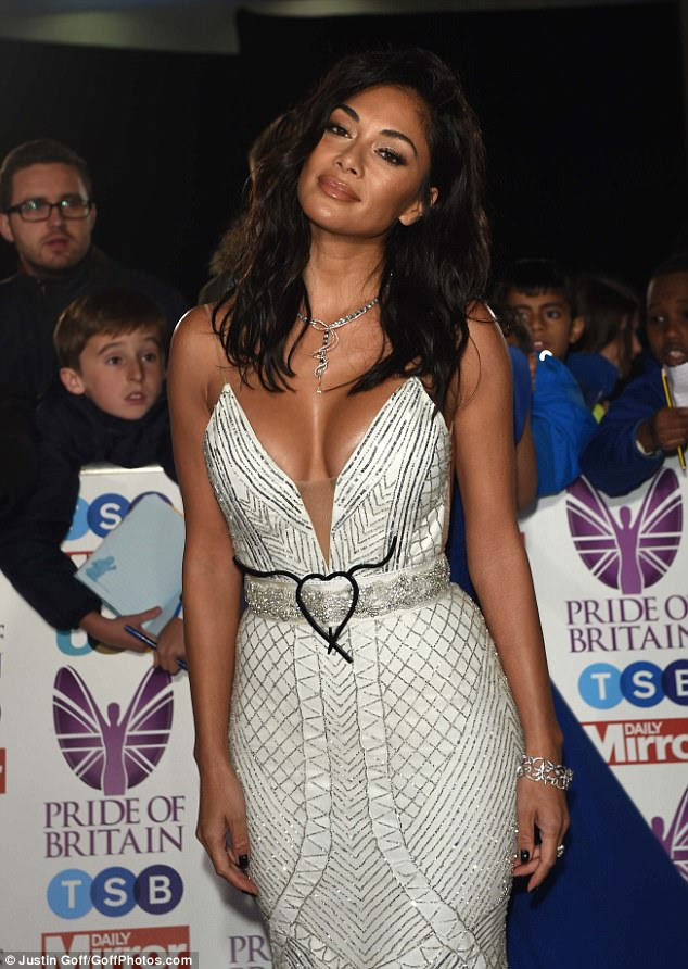 Fit to bust:Nicole Scherzinger showed no signs of stopping her busty displays on Monday night, as she slipped into another low-cut look for the 2017 Pride of Britain Awards