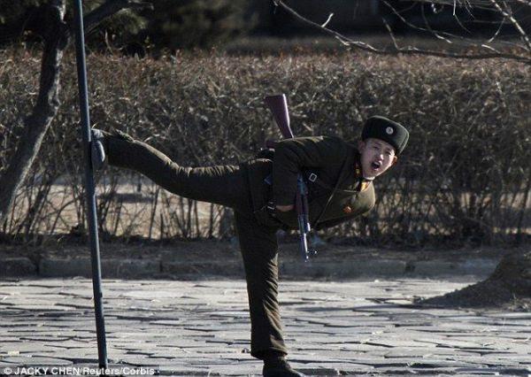 A North Korean soldier at Sinuiju on the Yalu River bank.