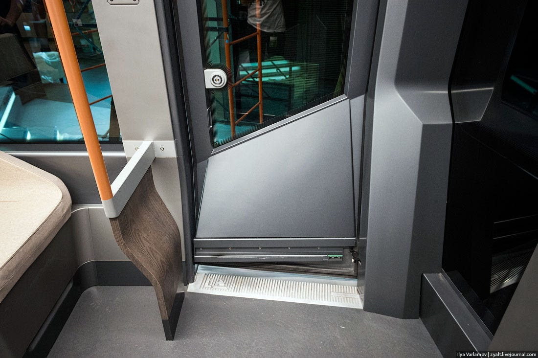 The doors slide open and are operated by a touch screen.