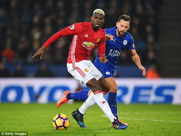 Pogba (left) shields the ball from midfielder Danny Drinkwater (right) during the clash