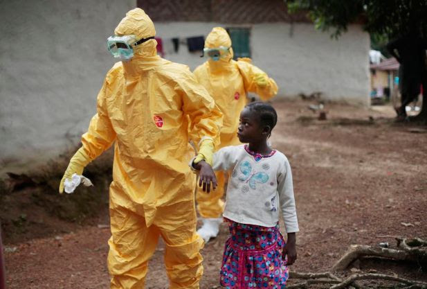 Nine-year-old Nowa Paye is taken to an ambulance after showing signs of the Ebola infection in the village of Freeman Reserve, about 30 miles north of Monrovia, Liberia,Tuesday Sept. 30, 2014.