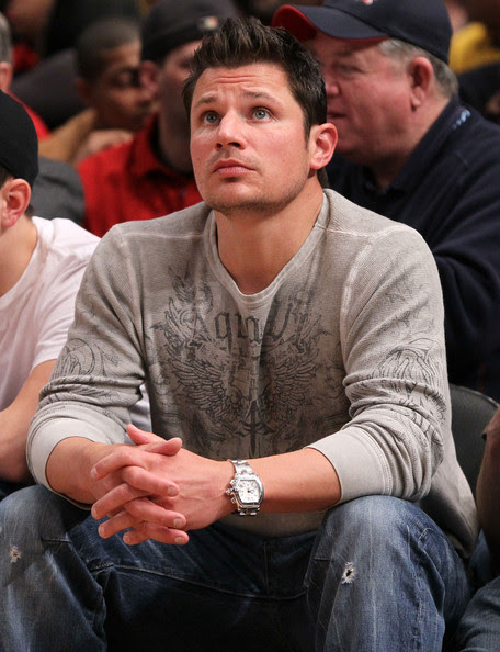 Singer  Nick Lachey attends the game between the Cincinnati Bearcats and the  West Virginia Mountaineers during the quarterfinal of the 2010 NCAA Big  East Tournament at Madison Square Garden on March 11, 2010 in New York  City.