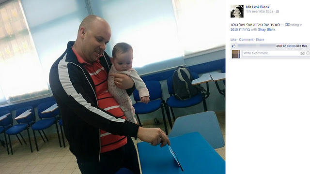 Holding the baby in Tel Aviv.