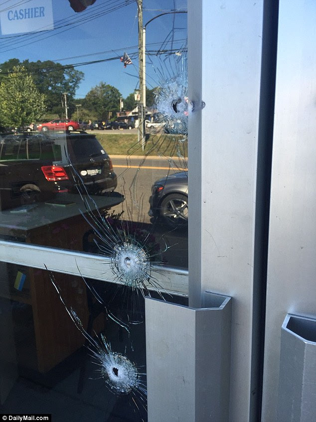 Damage: Police said the shooter had used buckshot to open fire on his former boss
