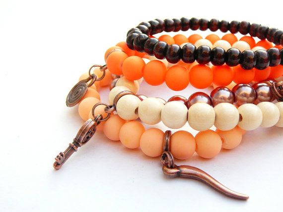 Set of five coral light salmon brown ivory colored stretch stacking bracelets - wood and glass beads - copper colored charms on Etsy, $13.17