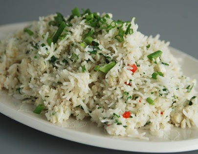 Crab Rice - Cooked rice tossed in crab meat, coconut milk fresh red chillies and served garnished with...