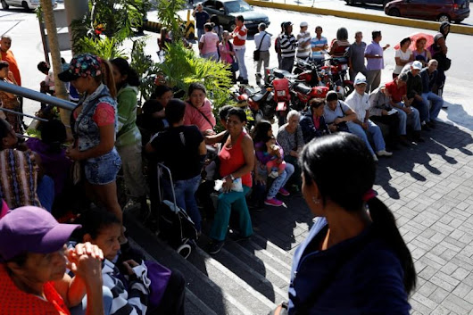 Caracas shops mobbed as Venezuela's Maduro forces price cuts