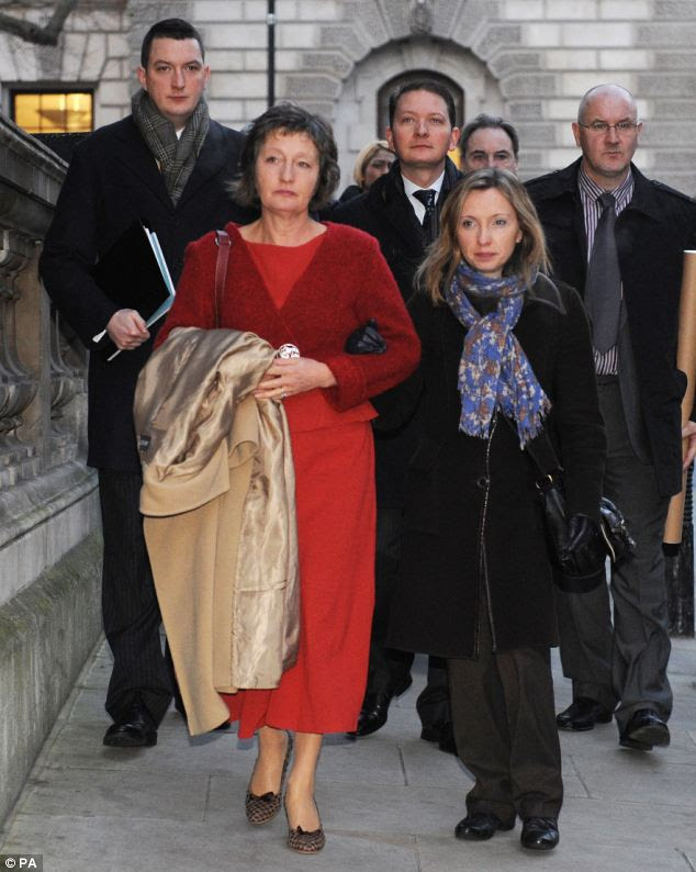 Pat Finucane's widow Geraldine today arrived at the House of Parliament with her children John (left), Michael (centre) and Katherine at the Houses of Parliament in central London to read the review of the report into her husband's murder