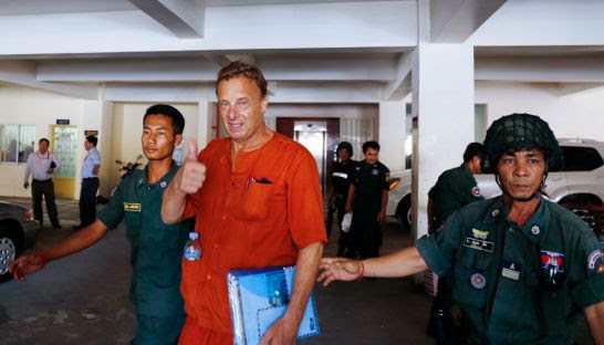 Brian Naswall is escorted out of Phnom Penh Municipal Court in June after being sentenced to ten years in jail for sexually abusing underage girls.