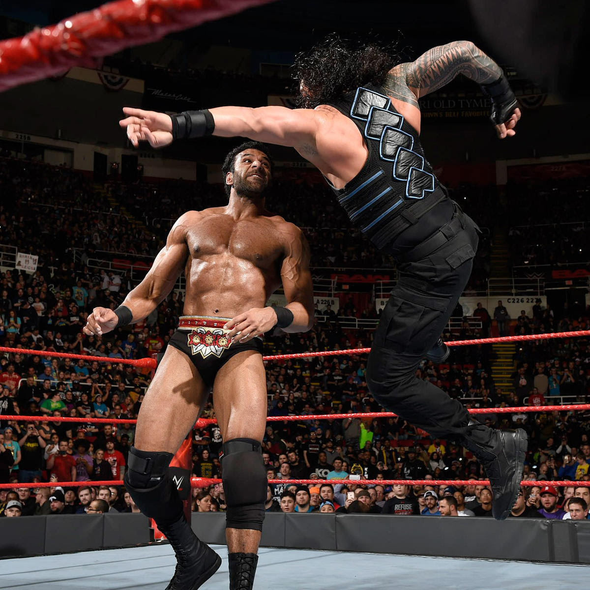 Reigns leaps into the air to deliver a devastating Superman Punch to Mahal.