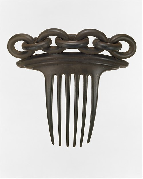 1851 Vulcanite hair comb, from The Met.