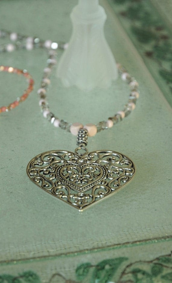 Gorgeous Necklace  handmade beaded with metal heart pendant