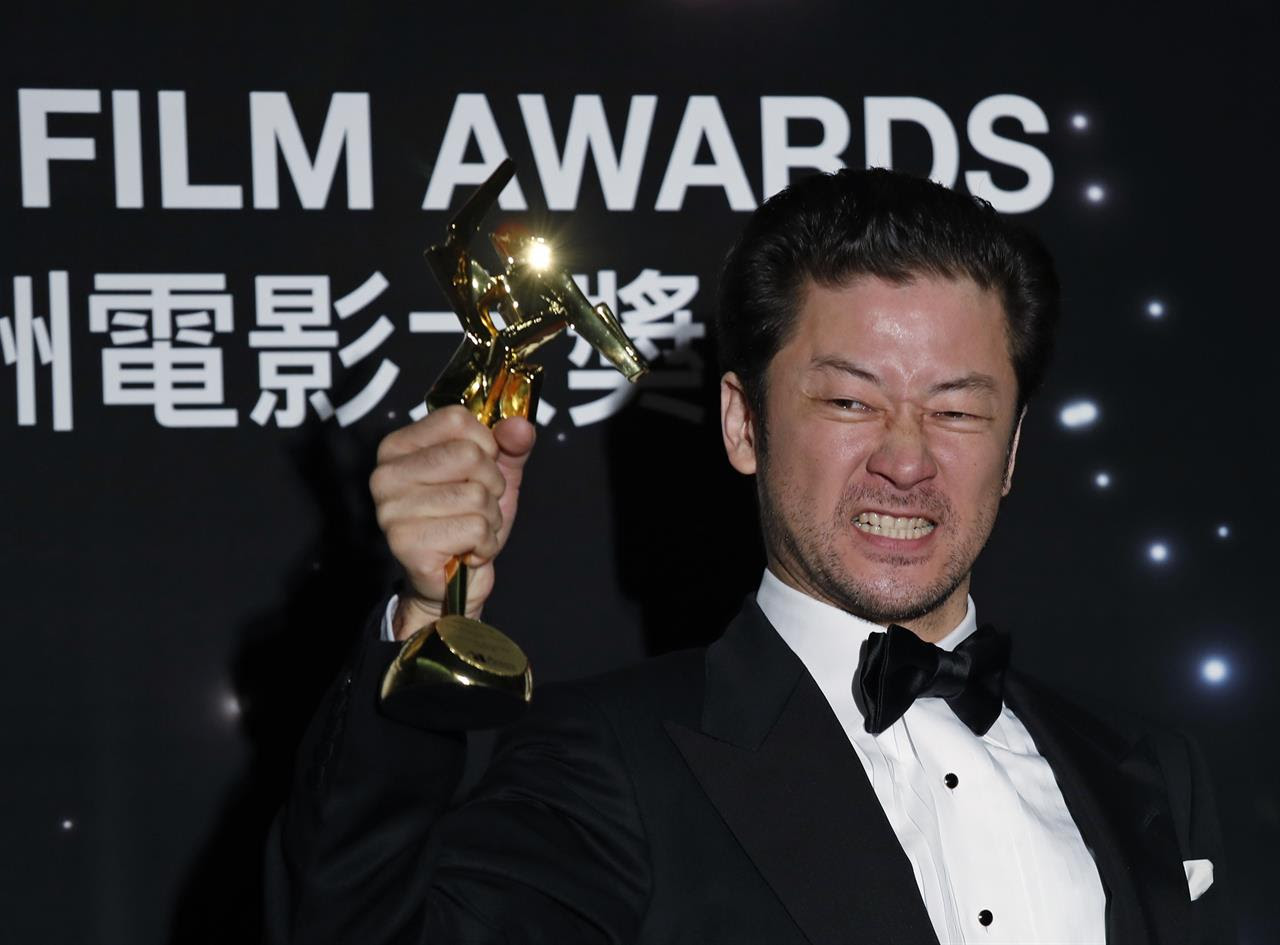 In this Tuesday, March 21, 2017 photo, Japanese actor Tadanobu Asano poses after winning the Best Actor Award of the Asian Film Awards in Hong Kong.
