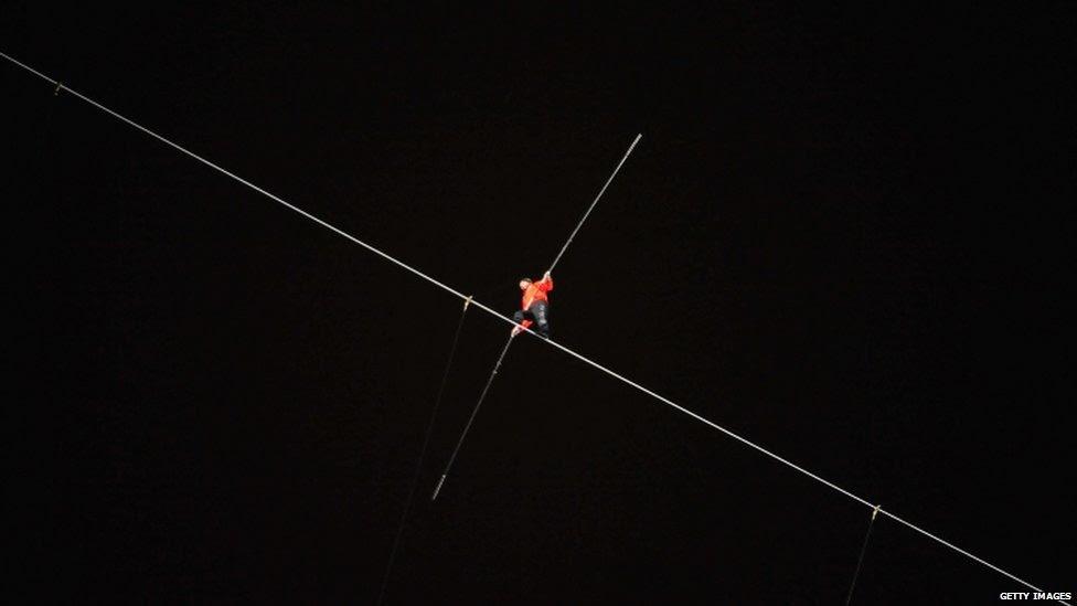 Nik Wallenda walks on a wire