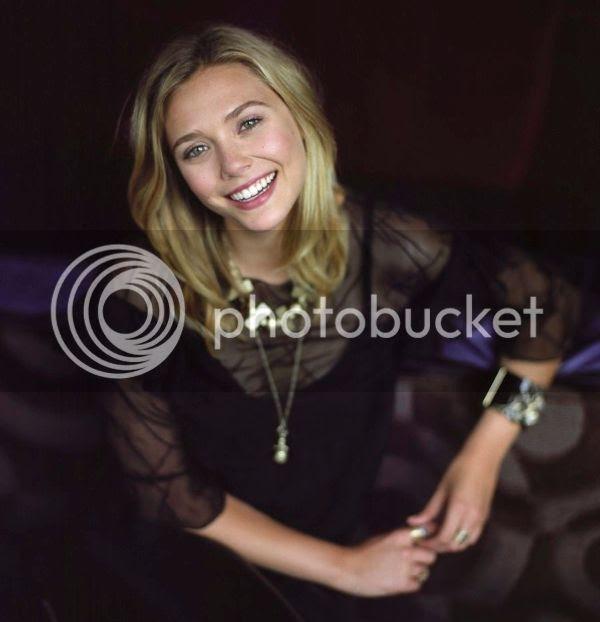 ELIZABETH OLSEN LIZZIE NEW YORK TIMES PHOTOSHOOT SHEER BLACK TOP DRESS GOLD NECKLACE SMILE 2