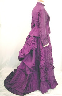 http://upload.wikimedia.org/wikipedia/commons/7/7c/1870s_purple_dress.jpg