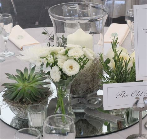 Table decoration with mirror glass, succulents, storm