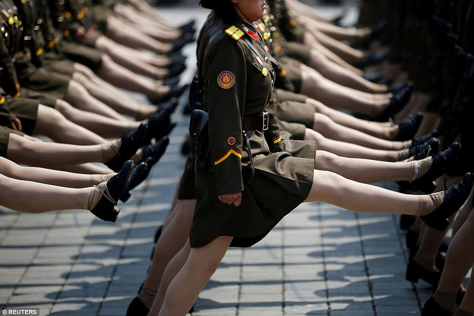 North Korean soldiers march during a military parade in Pyongyang on April 15 to mark the 105th birth anniversary of the dictator Kim Il-sung, who in 1948 founded the Kim regime, which still rules the state to this day