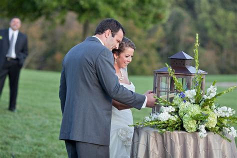 great idea for outdoor wedding, light unity candle in a