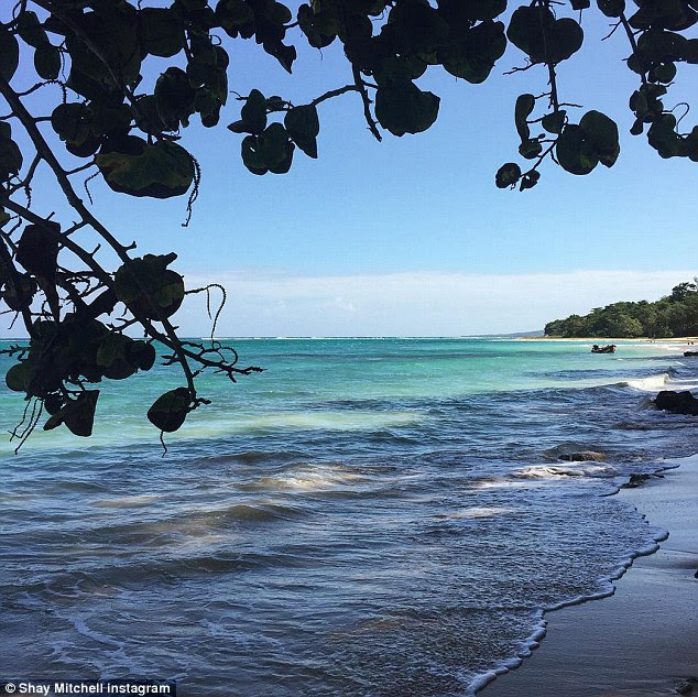 Idyllic break: Surely making all her fans envious, the Toronto native posted a gorgeous shot of the beach and the blue waters of the Caribbean, saying, 'Backyard for the rest of the year'