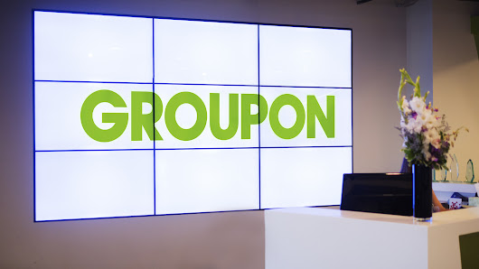 Groupon cuts about 100 jobs, most in Chicago