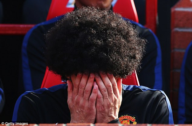 Guess who? Marouane Fellaini can't watch from the substitutes bench at Old Trafford