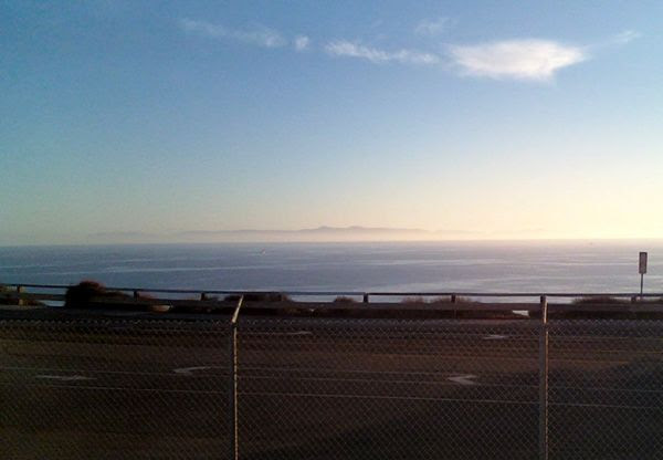 As the Sun begins to set, Catalina Island remains partially concealed by a marine layer 20-plus miles away from San Pedro, California, which is where I was when I took this photo in November of 2013.