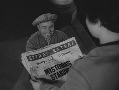 Elfin newspaper vendor