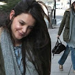 Dressed down Katie Holmes looks sombre as it emerges her style collection will no longer feature at New York Fashion Week