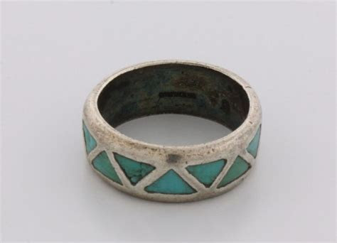RING: Men's st.silver wedding band w/ inlaid turquoise