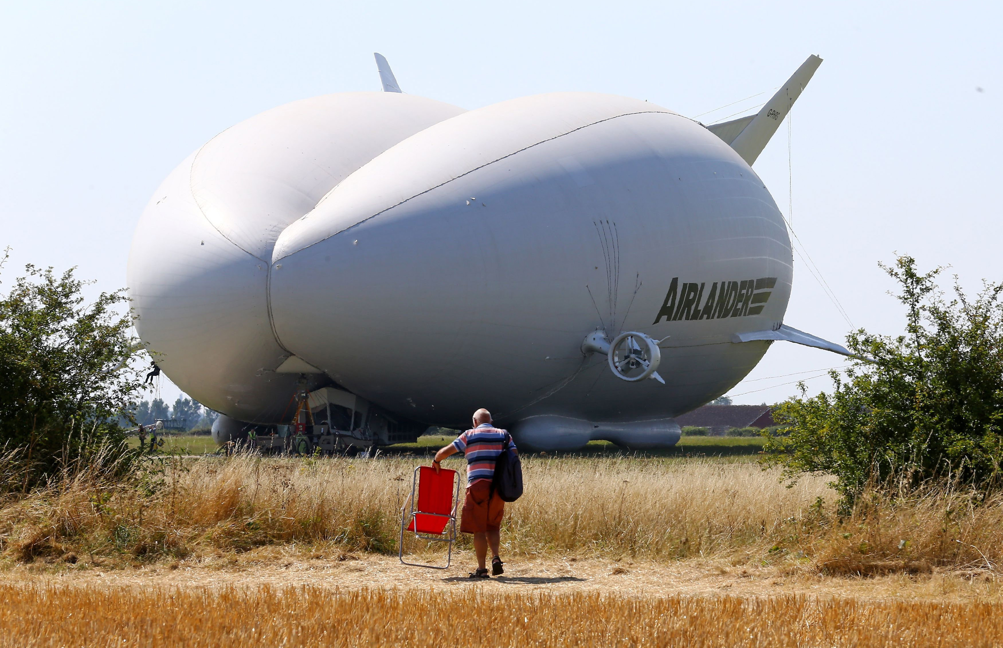 A man takes his seat as preparations are made for the maiden flight of the Airlander 10, the largest aircraft in the world, at Cardington airfield in Bedfordshire