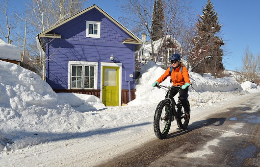 Winter bicycle commuters ride for sustainability, economy and lifestyle