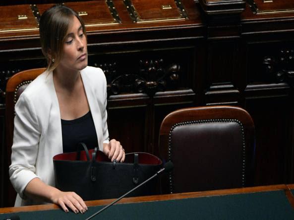 Maria Elena Boschi sui banchi del governo alla Camera quando era ministro per le Riforme (Ansa)