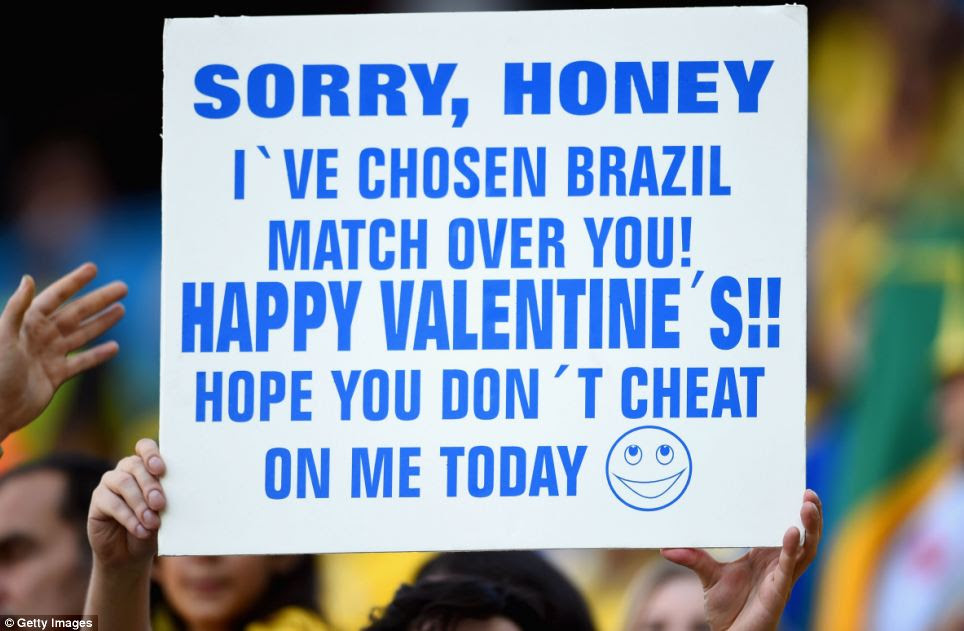 One fan pleaded for forgiveness from his significant other with a giant placard apologising for choosing football over a romantic night with his partner on Brazil's Valentine's Day