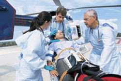 Doctors escorting patient from emergency helicopter