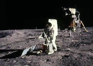 An Apollo astronaut sets up an experiment on the lunar surface
