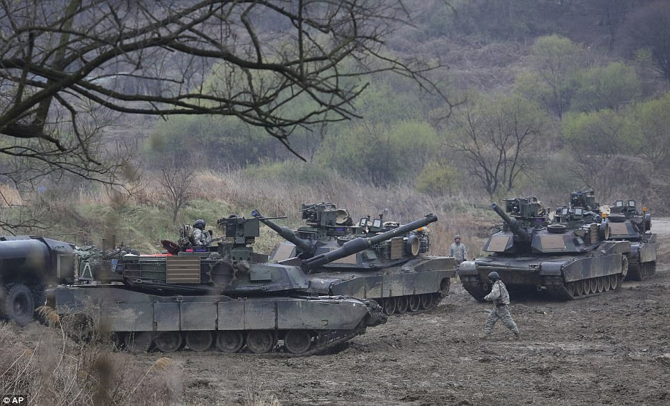 The rhetoric comes after North Korea warned President Donald Trump's 'troublemaking' and 'aggressive' tweets have pushed the world to the brink of thermo-nuclear war. Pictured, US Army tanks conducting a military exercise in South Korea