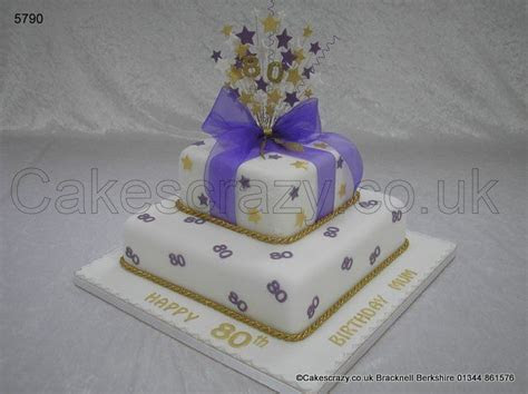 White two tier stacked parcel birthday cake finished in