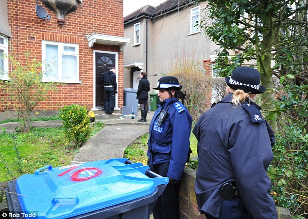 Probe: Officers were called to the property in north-west London at 5pm yesterday evening. A woman and her two sons were found dead