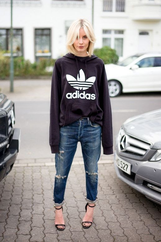Le Fashion Blog Blogger Style Sporty Chic Athleisure Trend Black Adidas Hoodie Ripped Boyfriend Jeans Heeled Sandals With Ankle Straps Via Lisa RVD